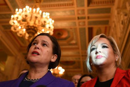 Sinn Fein President Mary Lou McDonald (L) and Sinn Fein Deputy Michelle O'Neill speak during a news conference in Parliament Buildings at Stormont in Belfast