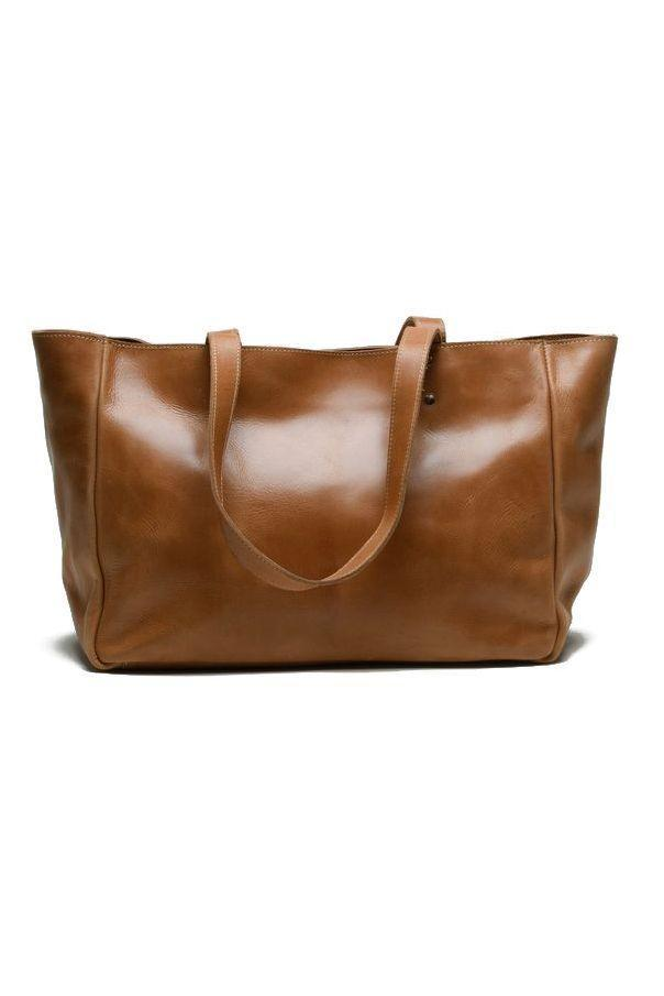 """<p><strong>Unoeth</strong></p><p>unoeth.com</p><p><strong>$188.00</strong></p><p><a href=""""https://unoeth.com/collections/all-products/products/sheba-leather-tote-walnut"""" rel=""""nofollow noopener"""" target=""""_blank"""" data-ylk=""""slk:Shop Now"""" class=""""link rapid-noclick-resp"""">Shop Now</a></p><p>You're going to want to make this worn-in wonder your every day bag. It even looks good when you don't have much in it, the slouchy-ness makes for a nonchalant, cool-girl attitude.</p>"""