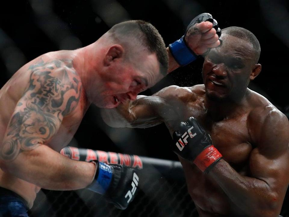 Kamaru Usman (right) will again defend his UFC welterweight title against Colby Covington (Getty Images)