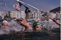 """<p>This is a <a href=""""https://outdoorswimmer.com/blogs/the-unexpected-and-unwanted-consequences-of-finas-poorly-conceived-wetsuit-ruling"""" rel=""""nofollow noopener"""" target=""""_blank"""" data-ylk=""""slk:relatively recent rule"""" class=""""link rapid-noclick-resp"""">relatively recent rule</a>. Basically, if a body of water is above 20 degrees celsius, wet suits are a no-go. But if the water temperature drops below 16 degrees celsius, swimmers are <em>required</em> to wear a wet suit.</p>"""