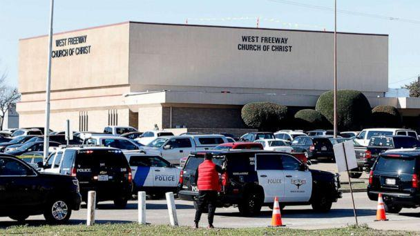 PHOTO: Law enforcement and the media work outside the West Freeway Church of Christ after a shooting took place during services, Dec. 29, 2019, in White Settlement, Texas. (Stewart F. House/Getty Images)