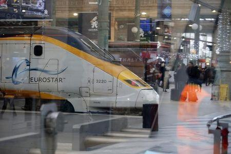 An idle high speed Eurostar train is seen through glass panels at the Paris Gare du Nord train station in Paris after the suspension rail traffic due to smoke coming out of the Channel tunnel