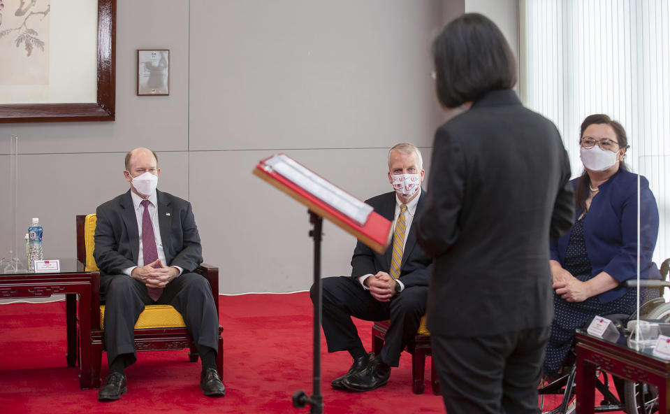 In this photo released by the Taiwan Presidential Office, President Tsai Ing-wen meets with from left; U.S. Democratic Sen. Christopher Coons of Delaware, Republican Sen. Dan Sullivan of Alaska and Democratic Sen. Tammy Duckworth of Illinois in Taipei, Taiwan on Sunday, June 6, 2021. The U.S. will give Taiwan 750,000 doses of COVID-19 vaccine, part of President Joe Biden's move to share tens of millions of jabs globally, three American senators said Sunday, after the self-ruled island complained that China is hindering its efforts to secure vaccines as it battles an outbreak. (Taiwan Presidential Office via AP)