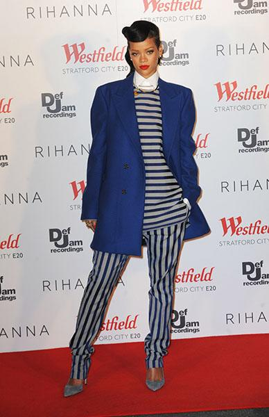 Rihanna prepares for first of two London shows - NaNa saved the cheeky look for London, appropriately, turning up in a Raf Simons cobalt coat and white collared shirt layered under a Spring 2013 Acne top and pants. Most of the #RihannaPlane 150 opted to sleep through this performance.