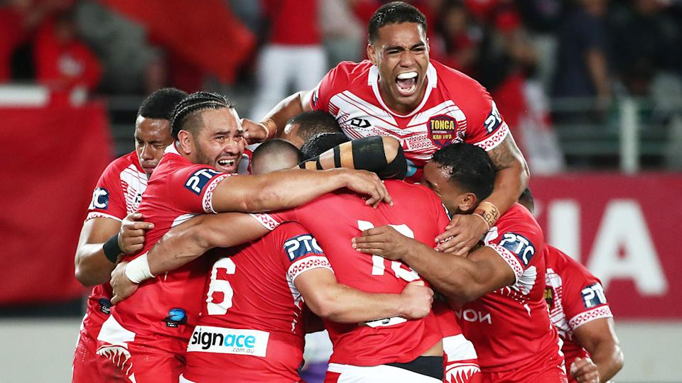 Pictured here, Tongan players celebrate after beating Australia in a 2019 rugby league Test match.