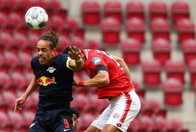Leipzig's Danish forward Yussuf Poulsen (L) scored and set up two more goals against Mainz on Sunday despite suffering torn ankle ligaments