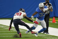 Detroit Lions running back Kerryon Johnson (33) runs out of bounds as Houston Texans strong safety Justin Reid (20) defends during the first half of an NFL football game, Thursday, Nov. 26, 2020, in Detroit. (AP Photo/Paul Sancya)