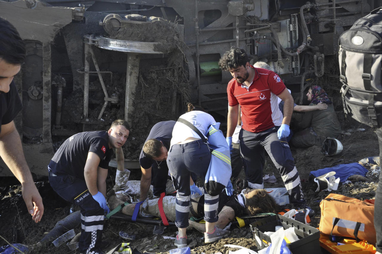 <p>Emergency services rescue victims from overturned train cars near a village in Tekirdag province, Turkey, July 8, 2018. (Photo: Mehmet Yirun/DHA-Depo Photos via AP) </p>