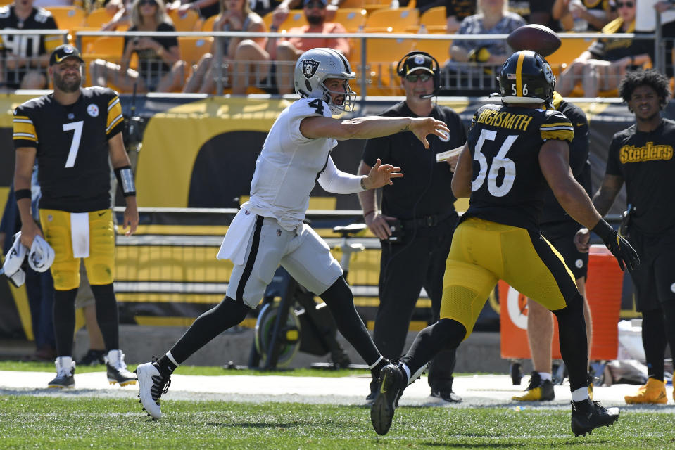 Las Vegas Raiders quarterback Derek Carr (4) gets off a pass under pressure by Pittsburgh Steelers linebacker Alex Highsmith (56) during the second half of an NFL football game in Pittsburgh, Sunday, Sept. 19, 2021. (AP Photo/Don Wright)