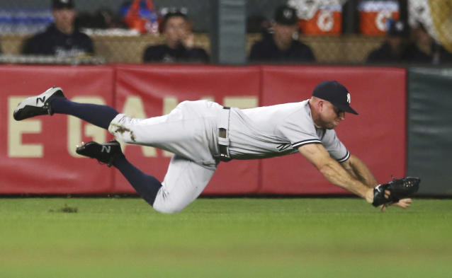 New York Yankees left fielder Brett Gardner dives for the ball hit by Minnesota Twins' Johnny Field in the second inning of a baseball game Monday, Sept. 10, 2018, in Minneapolis. (AP Photo/Jim Mone)