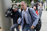 Russian lawyer Ivan Pavlov, center, walks to attend a court session after speaking to the media at Moscow Court, in Moscow, Russia, Wednesday, June 9, 2021. A court is expected to outlaw the organizations founded by Russian opposition leader Alexei Navalny. Prosecutors have asked the Moscow City Court to designate Navalny's Foundation for Fighting Corruption and his sprawling network of regional offices as extremist organizations. The extremism label also carries lengthy prison terms for activists who have worked with the organizations, anyone who donated to them, and even those who simply shared the groups' materials. (AP Photo/Alexander Zemlianichenko)