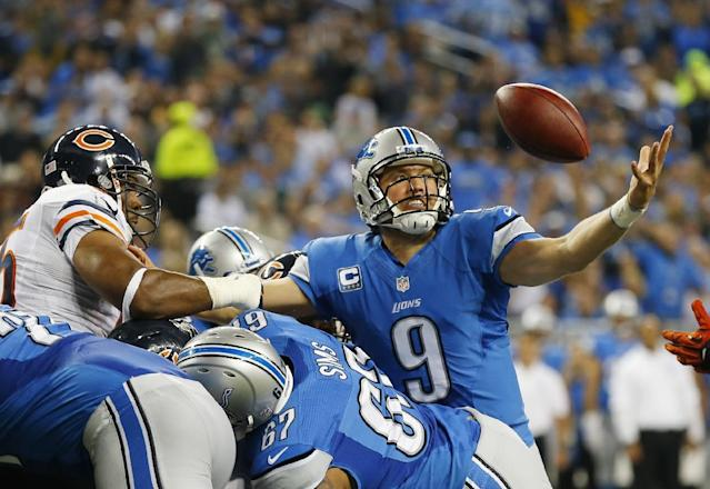 Detroit Lions quarterback Matthew Stafford (9) reaches out to recover his own fumble, and score as he crossed the goal line during the second quarter of an NFL football game against the Chicago Bears at Ford Field in Detroit, Sunday, Sept. 29, 2013. (AP Photo/Paul Sancya)