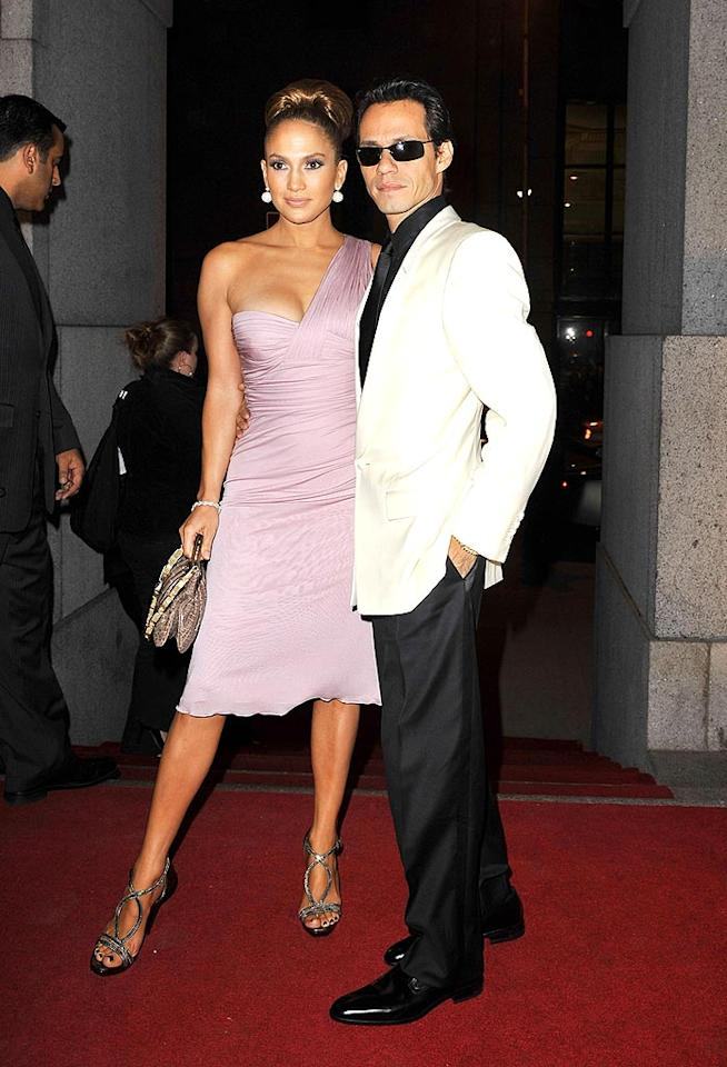 """Jennifer Lopez strikes a pose in a lavender Versace frock alongside hubby Marc Anthony as the couple arrives at the 25th Annual Night of Stars Gala at Cipriani Wall Street in NYC. SGP Italia srl/<a href=""""http://www.wireimage.com"""" target=""""new"""">WireImage.com</a> - October 23, 2008"""
