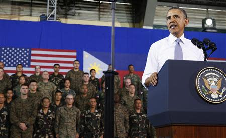 U.S. President Barack Obama speaks to military troops at the Fort Bonifacio Gymnasium in Manila, April 29, 2014. REUTERS/Larry Downing