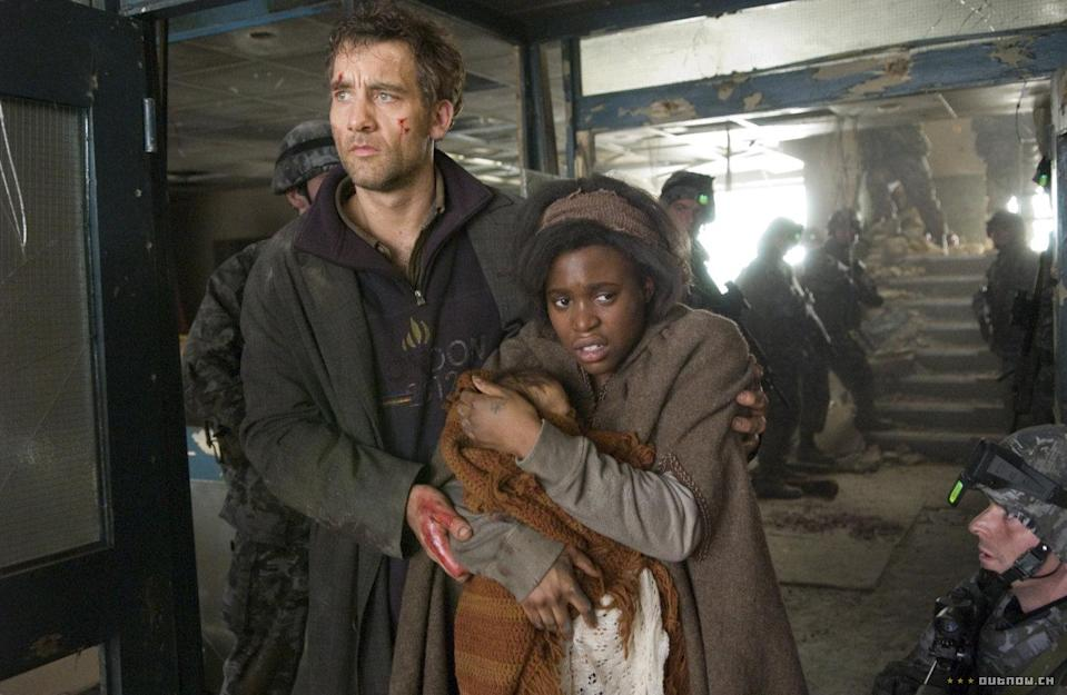 Clive Owen and Clare-Hope Ashitey seek a safe haven in 'Children Of Men'. (Universal)