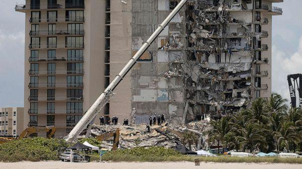 PHOTO: Members of the South Florida Urban Search and Rescue team look for possible survivors in the partially collapsed 12-story Champlain Towers South condo building, June 26, 2021, in Surfside, Florida. (Joe Raedle/Getty Images)