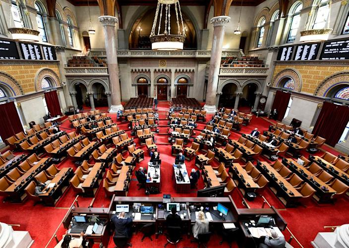 Members of the New York Assembly debate legislation in the Assembly Chamber at the New York State Capitol on March 30, 2021.