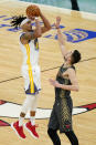 Golden State Warriors guard Damion Lee, left, shoots the winning 3-point shot against Chicago Bulls guard Tomas Satoransky during the second half of an NBA basketball game in Chicago, Sunday, Dec. 27, 2020. (AP Photo/Nam Y. Huh)