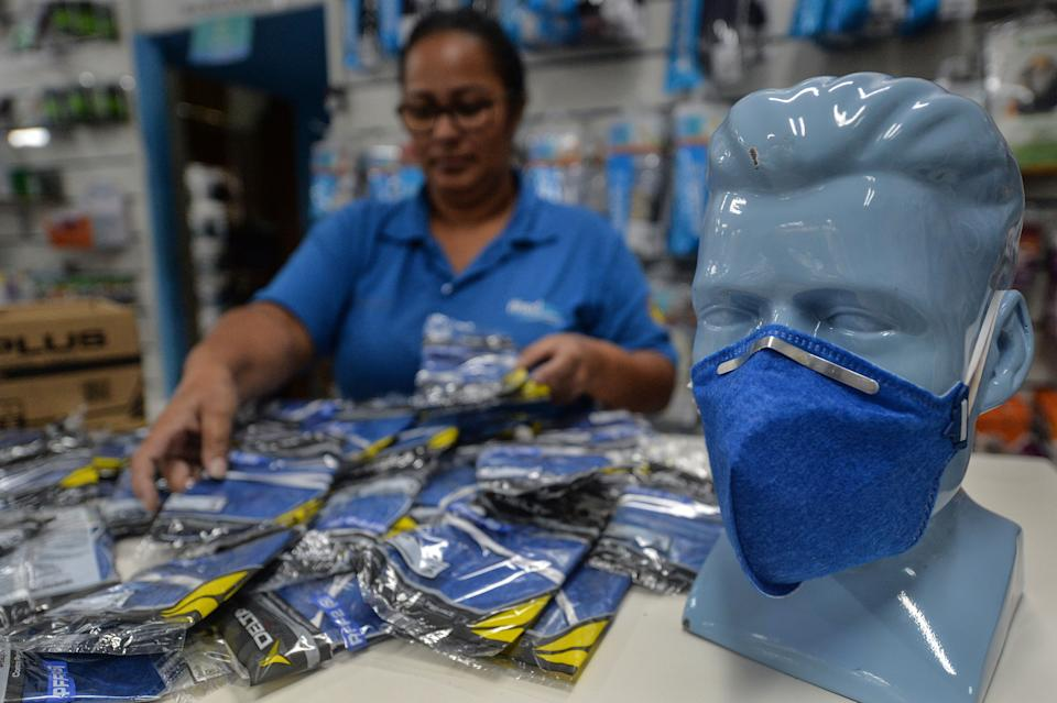 A worker at a medical supply store organizes PFF-2 respirator mask that customers are buying as a precaution against the spread of the new coronavirus, the COVID-19, in Sao Paulo, Brazil, on February 27, 2020. (Photo by Nelson ALMEIDA / AFP) (Photo by NELSON ALMEIDA/AFP via Getty Images)