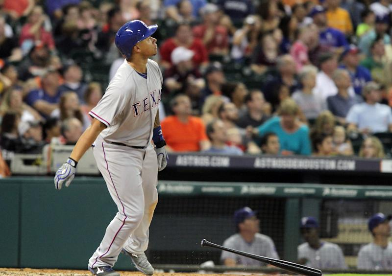 Texas Ranger's Michael Choice watches his three-run home run go into the stands against the Houston Astros in the fourth inning of a baseball game Friday, Aug. 29, 2014, in Houston. (AP Photo/Richard Carson)