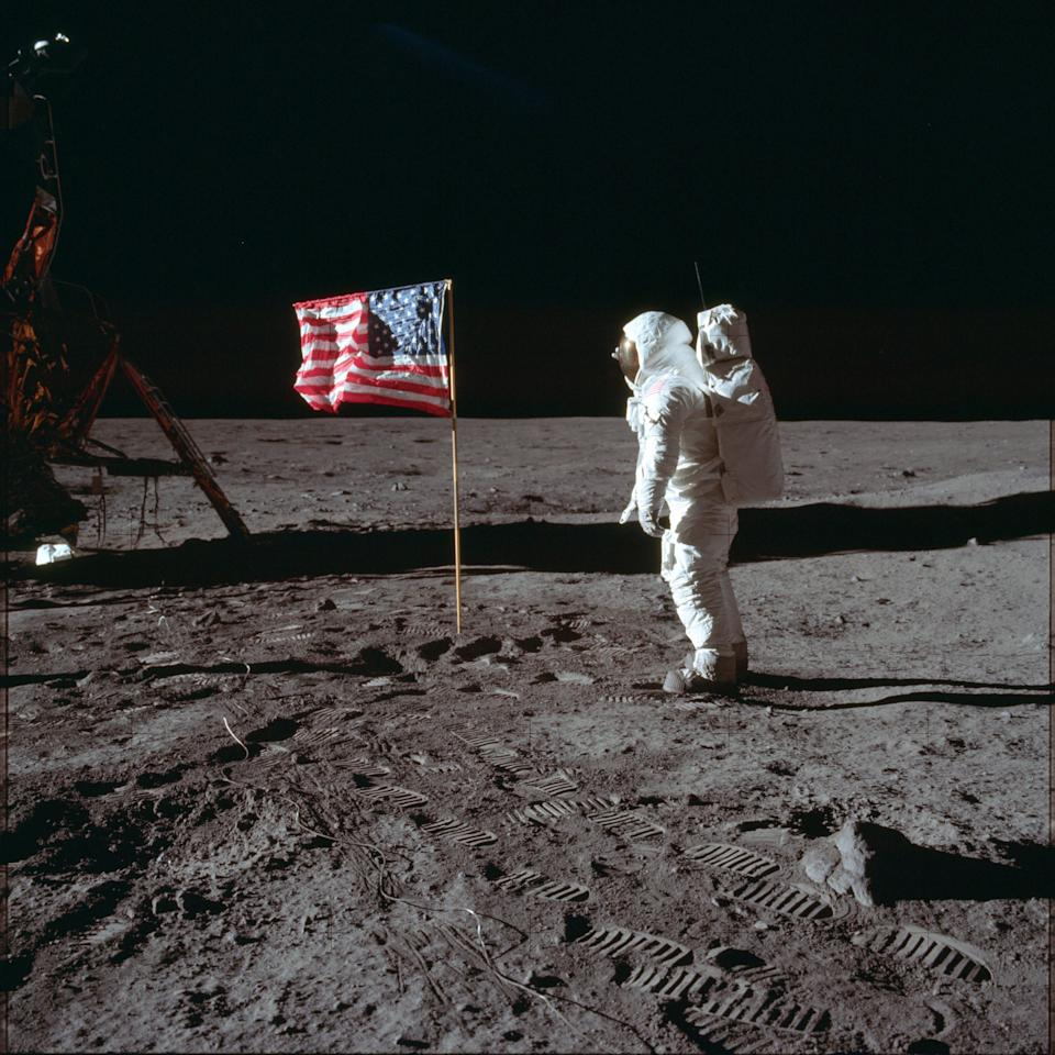 ADVANCE FOR USE SATURDAY, JULY 13, 2019 AND THEREAFTER-In this July 20, 1969 photo made available by NASA, astronaut Buzz Aldrin Jr. poses for a photograph beside the U.S. flag on the moon during the Apollo 11 mission. Aldrin and fellow astronaut Neil Armstrong were the first men to walk on the lunar surface with temperatures ranging from 243 degrees above to 279 degrees below zero. Astronaut Michael Collins flew the command module. (Neil Armstrong/NASA via AP) ORG XMIT: NYMO411