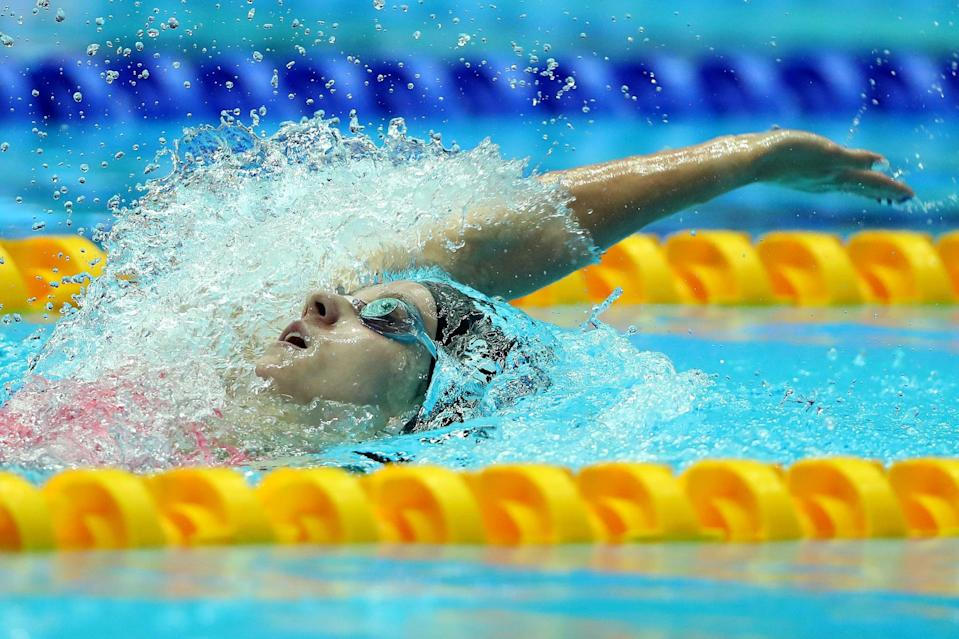 """<p><strong>Sport:</strong> Swimming<br> <strong>Country:</strong> USA</p> <p>Swimmer Regan Smith made major waves (sorry, we had to) when she <a href=""""https://swimswam.com/bio/regan-smith/"""" class=""""link rapid-noclick-resp"""" rel=""""nofollow noopener"""" target=""""_blank"""" data-ylk=""""slk:broke two world records"""">broke two world records</a> at the 2019 FINA World Championships, one of which belonged to Missy Franklin. The backstroke specialist is just 19 and recently <a href=""""https://www.popsugar.com/fitness/swimmer-regan-smith-qualifies-for-2021-olympics-48377477"""" class=""""link rapid-noclick-resp"""" rel=""""nofollow noopener"""" target=""""_blank"""" data-ylk=""""slk:clinched her first Olympic berth"""">clinched her first Olympic berth</a> in the 100-meter backstroke, then followed up with a win in the 200-meter butterfly, so we'll see her in both events in Tokyo and possibly some relays as well.</p>"""