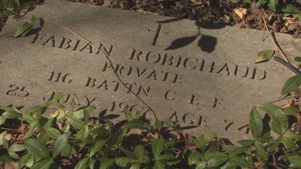 The stone memorializes Pte. Fabian Robichaud, a World War I veteran who died in 1967 at the age of 74. The family had never noticed it, as it was partially covered by vegetation, bushes and snow.  (Rob Krbavac - image credit)