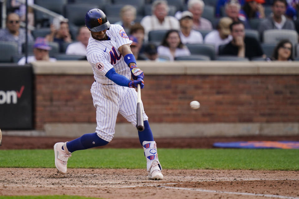 New York Mets' Kevin Pillar hits an RBI-single during the seventh inning of the first baseball game of a doubleheader against the Philadelphia Phillies, Friday, June 25, 2021, in New York. (AP Photo/Frank Franklin II)