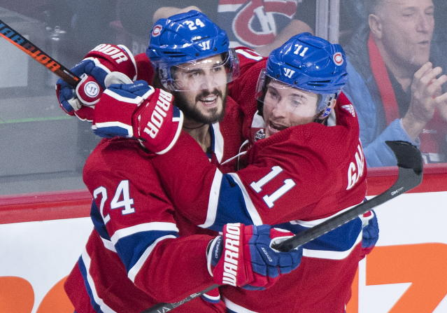 Montreal Canadiens' Phillip Danault (24) celebrates with teammate Brendan Gallagher after scoring during second period NHL hockey action against the St. Louis Blues, in Montreal, Saturday, Oct.12, 2019. (Graham Hughes/The Canadian Press via AP)