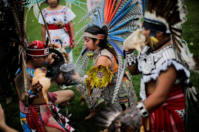 "<p>Revellers perform during a ""pow-wow"" celebrating the Indigenous Peoples' Day Festival in Randalls Island, in New York, Oct. 8, 2017. The festival is held as a counter-celebration to Columbus Day and to promote Native American culture and history. (Photo: Eduardo Munoz/Reuters) </p>"