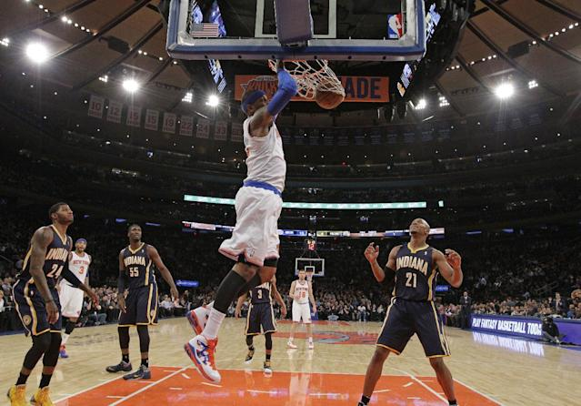 New York Knicks small forward Carmelo Anthony (7) dunks in front of Indiana Pacers defenders in the first half of their NBA basketball game at Madison Square Garden in New York, Wednesday, Nov. 20, 2013. (AP Photo/Kathy Willens)