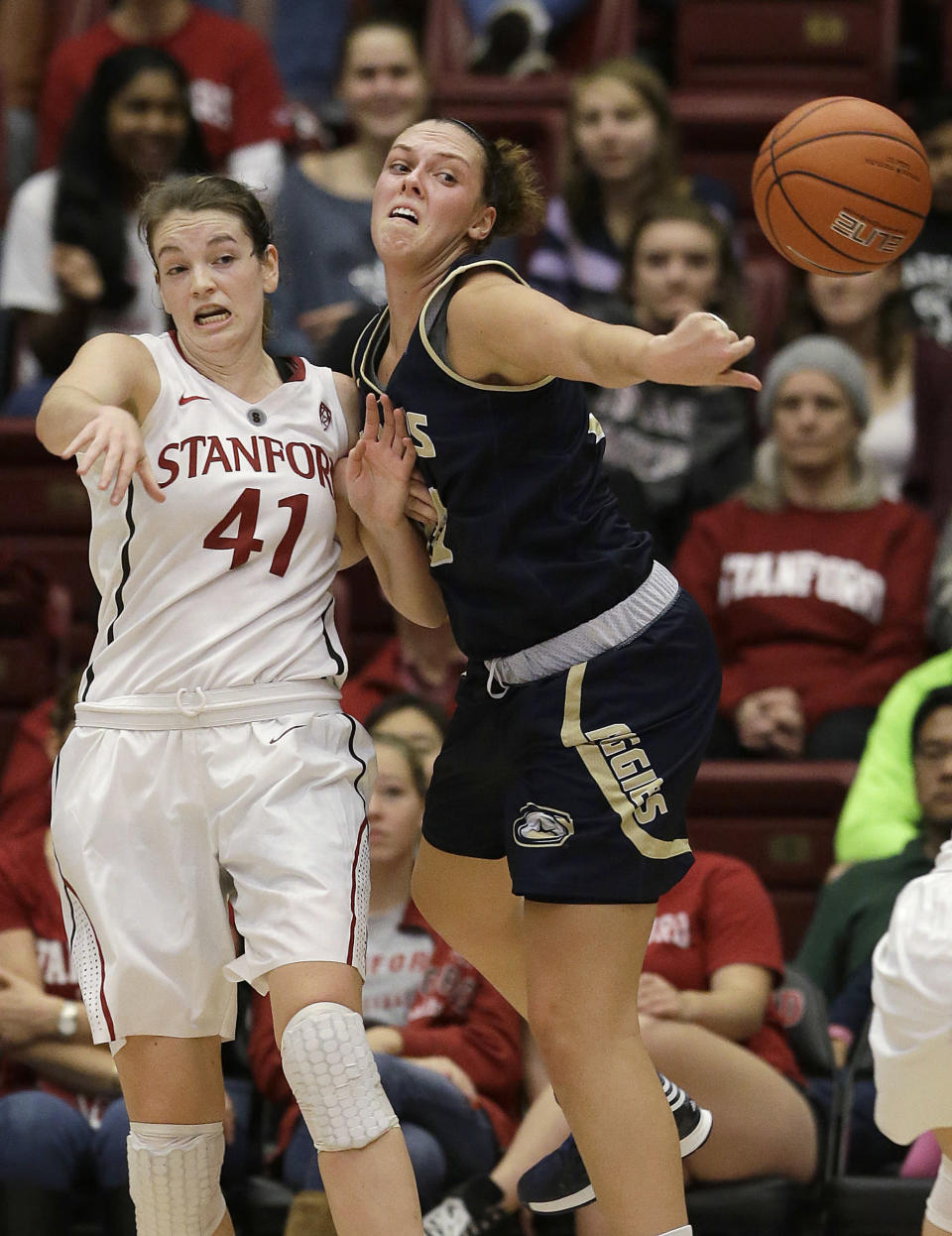 Stanford forward Bonnie Samuelson (41) passes the ball as UC Davis forward Celia Marfone defends during the first half of an NCAA college basketball game in Stanford, Calif., Monday, Dec. 22, 2014. (AP Photo/Jeff Chiu)