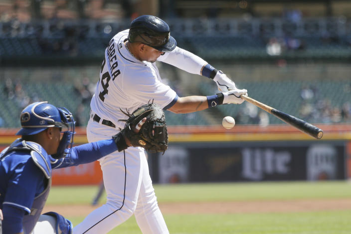 Detroit Tigers' Miguel Cabrera (24) swings for a strike with catcher Kansas City Royals' Salvador Perez (13) behind the plate during the first inning of a baseball game Sunday, April 25, 2021, in Detroit. Cabrera struck out in the first. (AP Photo/Duane Burleson)