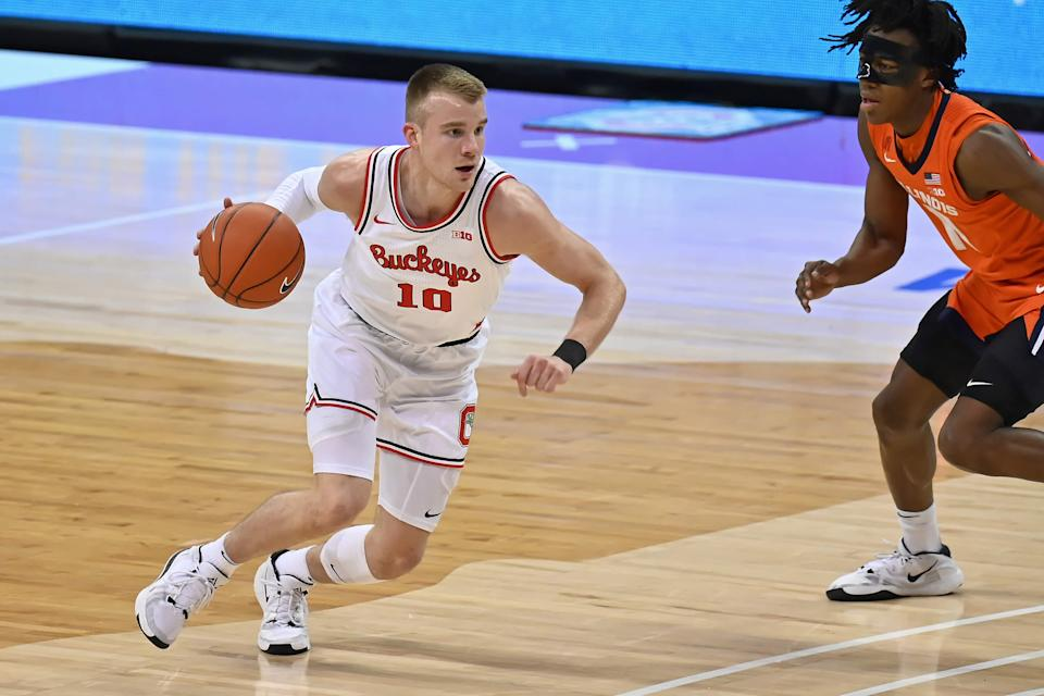 COLUMBUS, OH - MARCH 6:  Justin Ahrens #10 of the Ohio State Buckeyes controls the ball against the Illinois Fighting Illini at Value City Arena on March 6, 2021 in Columbus, Ohio.  (Photo by Jamie Sabau/Getty Images)
