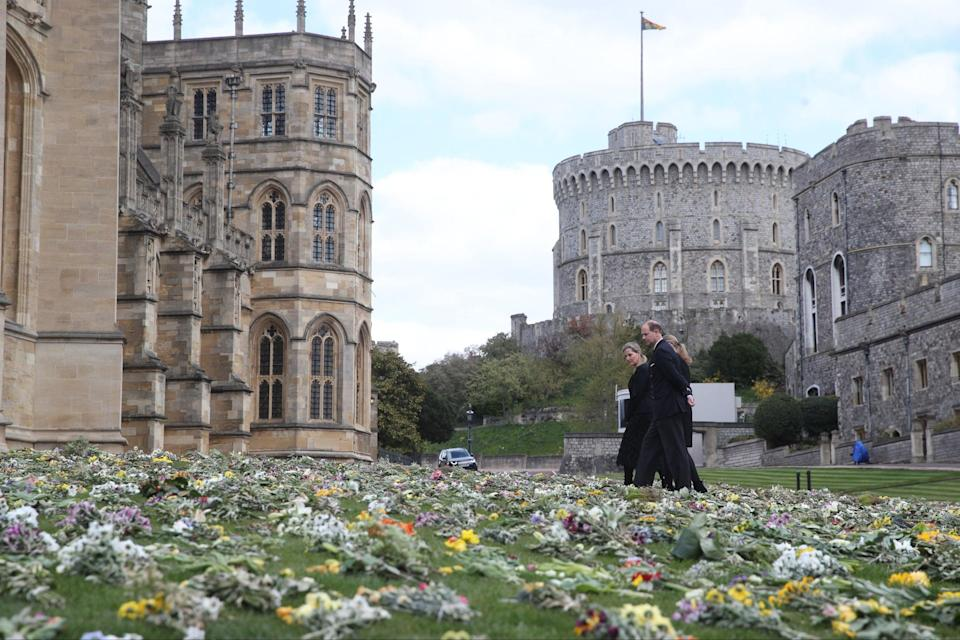 The Earl of Wessex and Lady Louise Windsor survey flowers outside St George's Chapel, at Windsor CastleGetty Images