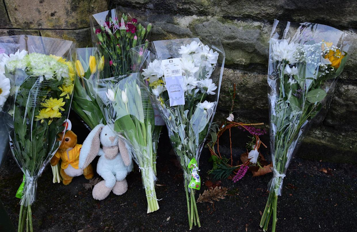 Tributes left at the gates of Brackenwood Park and Golf course, Bebington, Wirral the scene of where a baby boy was found dead.