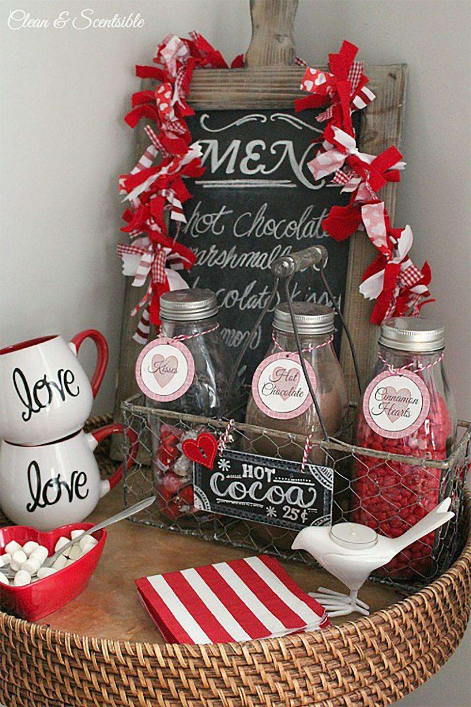 """<p>Nothing warms the heart more than a customized cup of hot cocoa.</p><p><strong>Get the tutorial at <a href=""""https://www.cleanandscentsible.com/valentines-day-decor/"""" rel=""""nofollow noopener"""" target=""""_blank"""" data-ylk=""""slk:Clean And Scentsible"""" class=""""link rapid-noclick-resp"""">Clean And Scentsible</a>.</strong></p><p><strong><a class=""""link rapid-noclick-resp"""" href=""""https://www.amazon.com/Best-Sellers-Office-Products-Chalkboards/zgbs/office-products/1069310?tag=syn-yahoo-20&ascsubtag=%5Bartid%7C10050.g.2971%5Bsrc%7Cyahoo-us"""" rel=""""nofollow noopener"""" target=""""_blank"""" data-ylk=""""slk:SHOP CHALKBOARDS"""">SHOP CHALKBOARDS</a><br></strong></p>"""