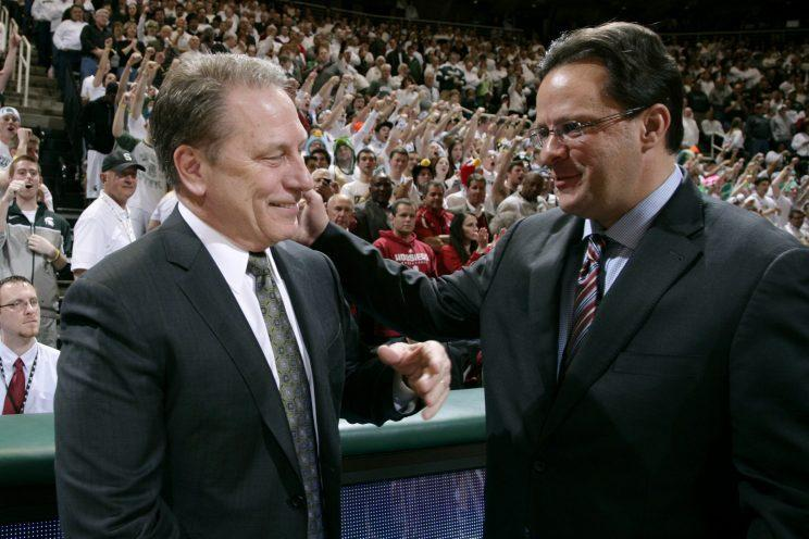 Tom Izzo and Tom Crean share a moment in 2013. (AP)