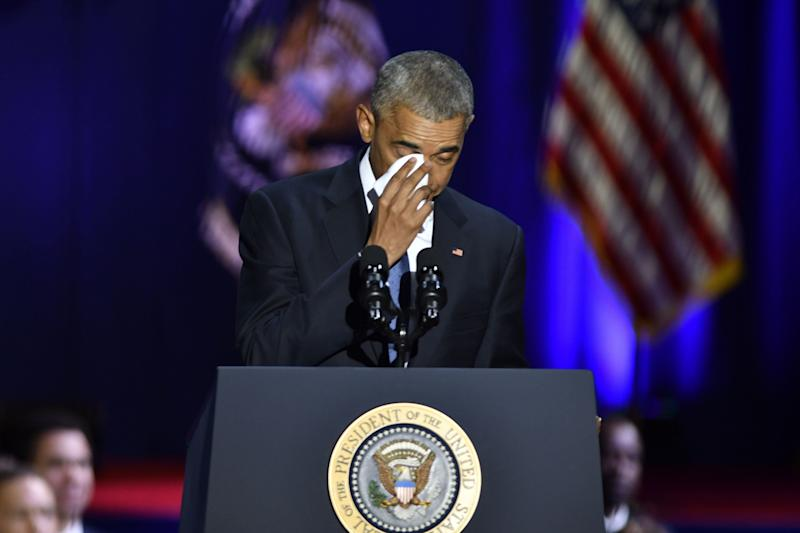 Obama wipes his tears while speaking about his wife, Michelle.