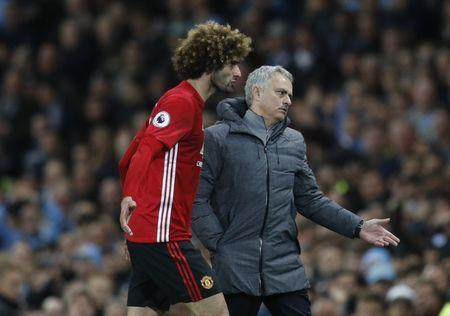 Manchester United's Marouane Fellaini after being sent off with manager Jose Mourinho