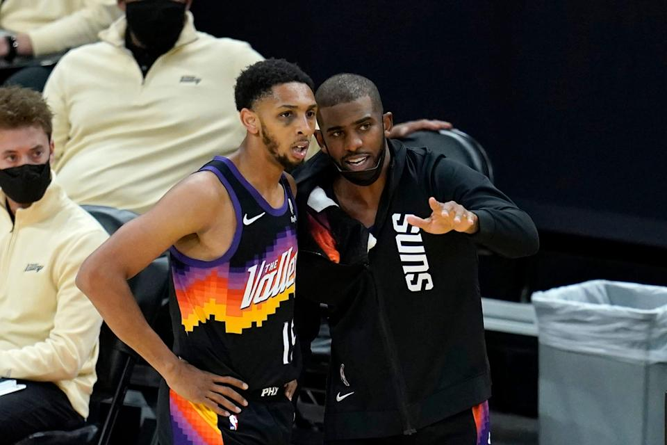 Phoenix Suns guard Chris Paul, right, talks with Suns guard Cameron Payne, left, during the first half of Game 2 of their NBA basketball first-round playoff series against the Los Angeles Lakers Tuesday, May 25, 2021, in Phoenix. (AP Photo/Ross D. Franklin)
