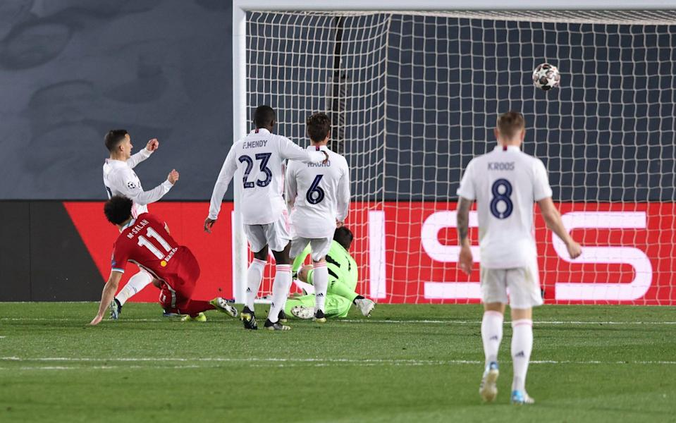 Mohamed Salah of Liverpool scores their team's first goal past Lucas Vazquez, Ferland Mendy, Nacho Fernandez and Thibaut Courtois - Angel Martinez/Getty Images