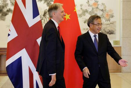 Britain's Chancellor of the Exchequer Philip Hammond meets Chinese Vice Premier Hu Chunhua at Diaoyutai State Guesthouse in Beijing, China, April 25, 2019. REUTERS/Jason Lee/Pool