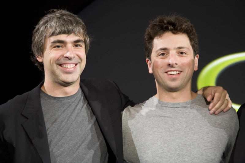 Larry Page (L) and Sergey Brin (R), the co-founders of Google, at a press event where Google and T-Mobile announced the first Android powered cellphone, the T-Mobile G1. (Photo by James Leynse/Corbis via Getty Images)