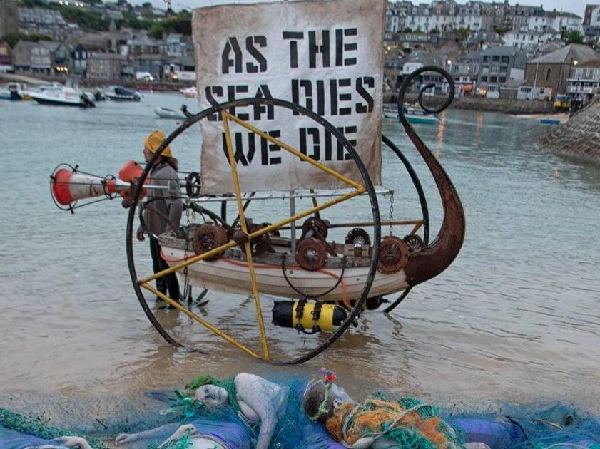 Ocean Rebellion protesters hold a demonstration in St Ives, Cornwall, on Friday, 11 June, to call on G7 leaders to take action to protect the world's oceans. (Guy Reece )