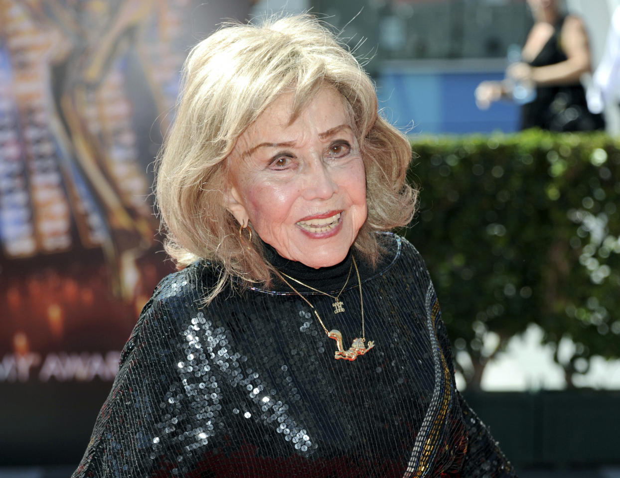 In this Sept. 15, 2013 file photo, June Foray arrives at the Primetime Creative Arts Emmy Awards at the then Nokia Theatre L.A. Live, in Los Angeles. Foray's niece, Robin Thaler, said Thursday, July 27, 2017, that Foray died at Wednesday in a Los Angeles hospital of cardiac arrest. She was 99. (Photo by Richard Shotwell/Invision/AP, File)