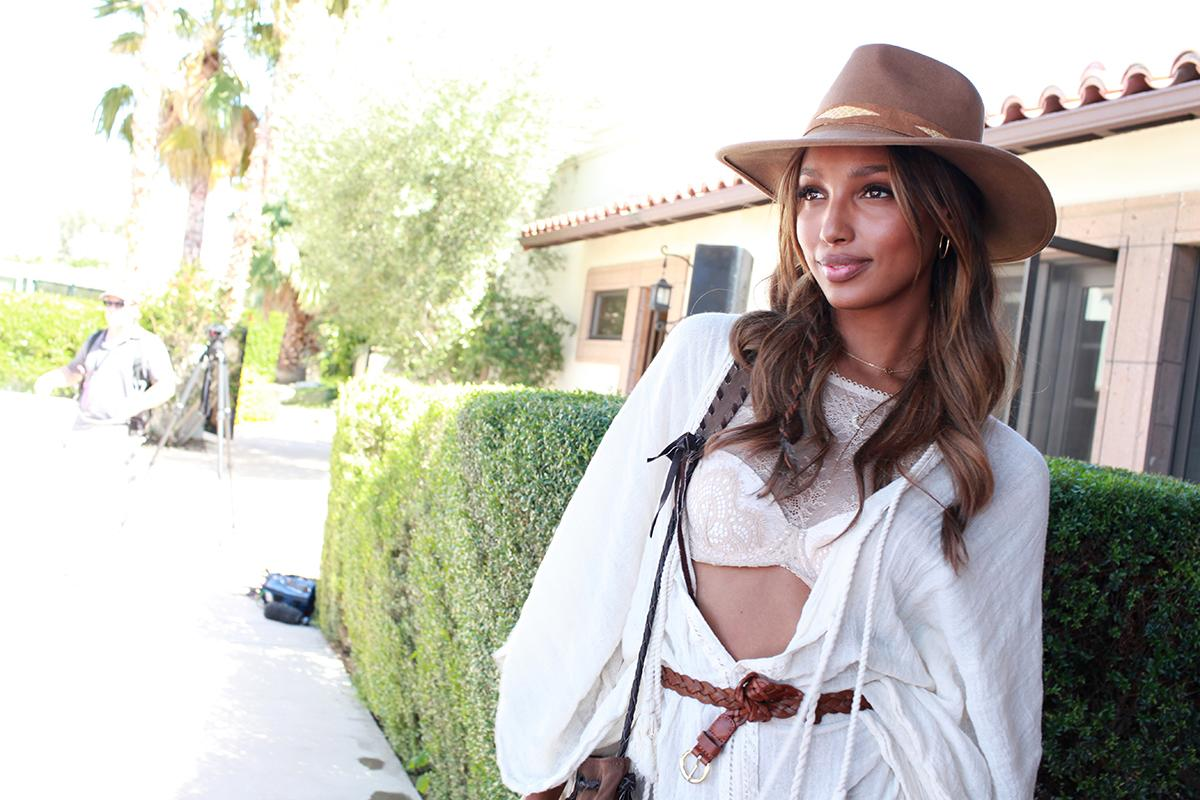<p>The fellow VS Angel brings sun-kissed hair and nude lips to the festival. Smart sun protection move with the fedora! (Photo: REX) </p>