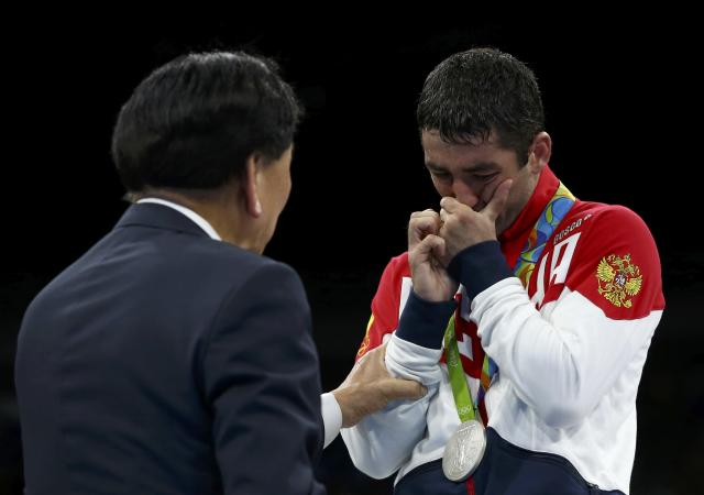 2016 Rio Olympics - Boxing - Victory Ceremony - Men's Fly (52kg) Victory Ceremony - Riocentro - Pavilion 6 - Rio de Janeiro, Brazil - 21/08/2016. Silver medallist Misha Aloian (RUS) of Russia reacts. REUTERS/Peter Cziborra TPX IMAGES OF THE DAY. FOR EDITORIAL USE ONLY. NOT FOR SALE FOR MARKETING OR ADVERTISING CAMPAIGNS.