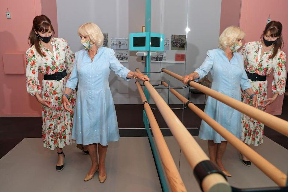 <p>Dame Darcey Bussell, President of the Royal Academy of Dance, and Camilla, Duchess of Cornwall pose next to a Ballet barre during a visit to 'On Point: Royal Academy of Dance at 100' at The V&A.</p>