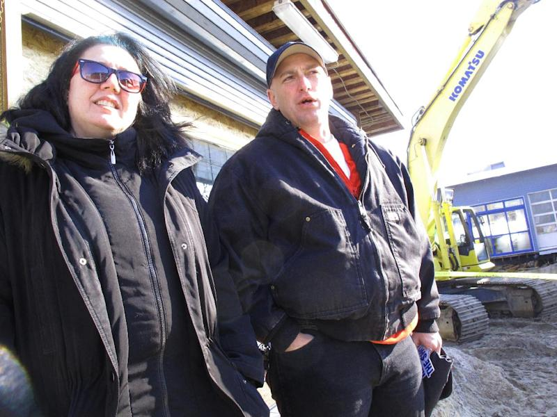 Linda Polites, left and Michael Riley, right, traveled from their shelter in Mercer County to Seaside Heights N.J. on Friday, Feb. 15, 2013 to watch the start of the reconstruction of the town's boardwalk that was destroyed by Superstorm Sandy. They were among Seaside Heights residents rescued by authorities during the storm, and still have not been able to return home. Mayor Bill Akers says the mile-long walkway should be done by May 10, but amenities like railings, lighting and ramps will come after that. (AP Photo/Wayne Parry)